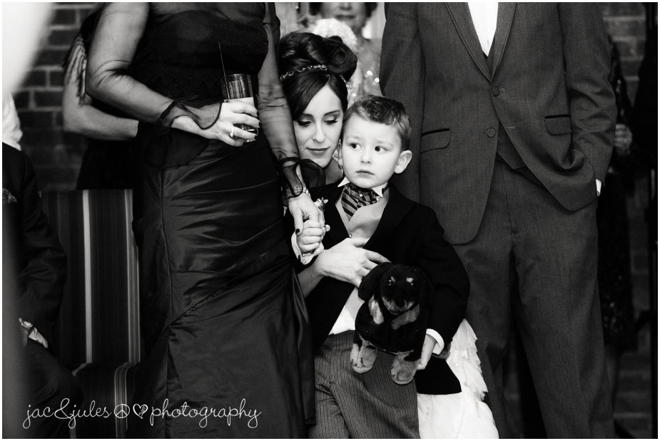 jacnjules photographs the bride and her son having a moment during the reception at ninety acres in peapack gladstone, nj