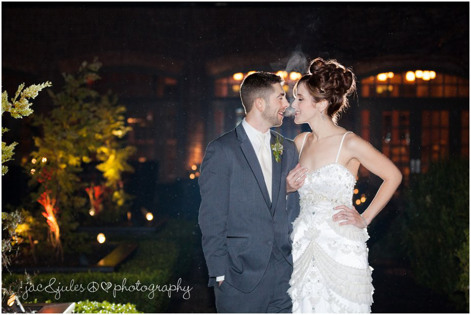 jacnjules photographs bride and groom at night in the rain at ninety acres at natirar in peapack gladstone, nj