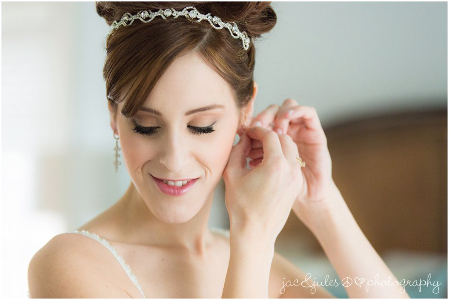 jacnjules photographs bride putting on her earrings at her home in franklin lakes nj