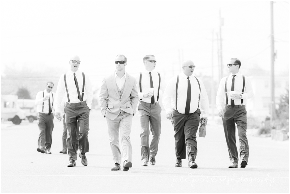 jacnjules photographs groomsmen on the beach in LBI near The State Room