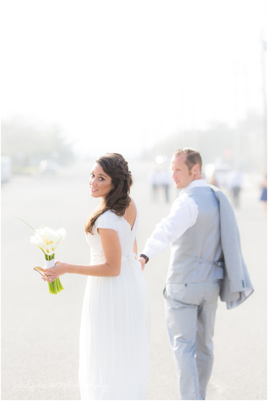jacnjules photograph the bride and groom on wedding day on the beach in LBI
