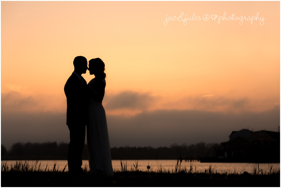 jacnjules photographs a bride and groom at sunset during their wedding at The State Room in LBI