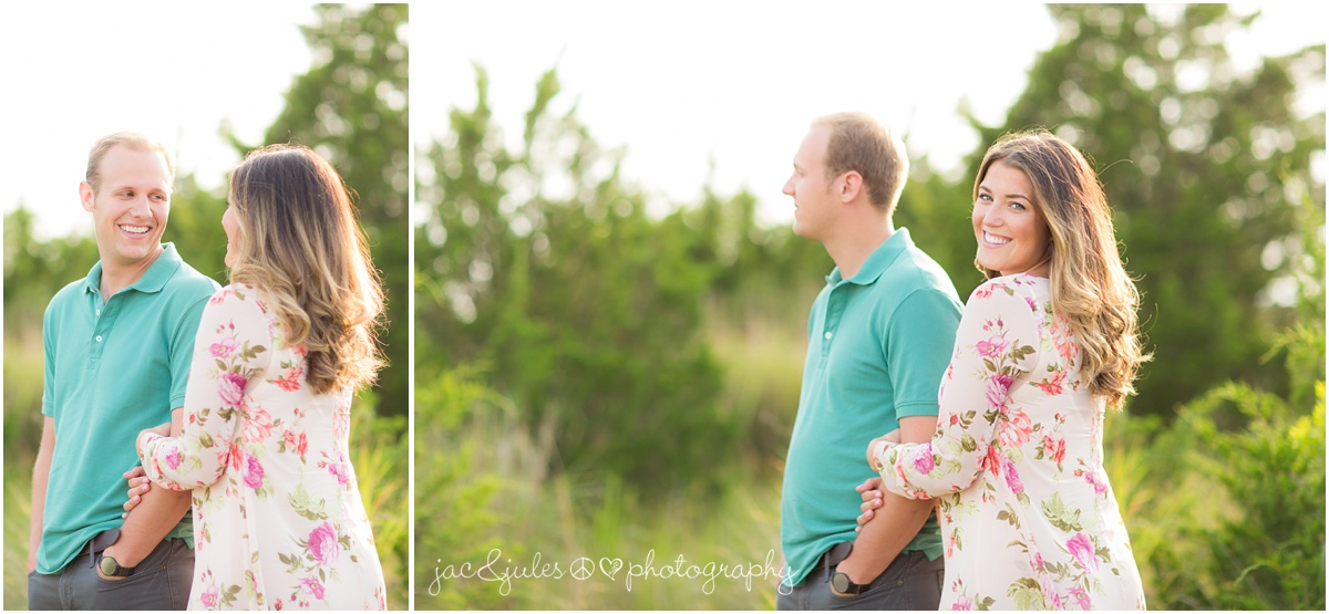 engaged couple in the dunes on the barnegat bay