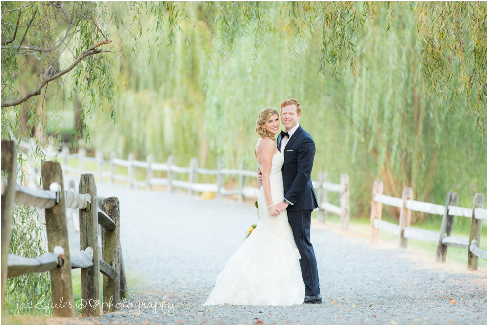 jacnjules photographs bride and groom at windows on the water at frogbridge