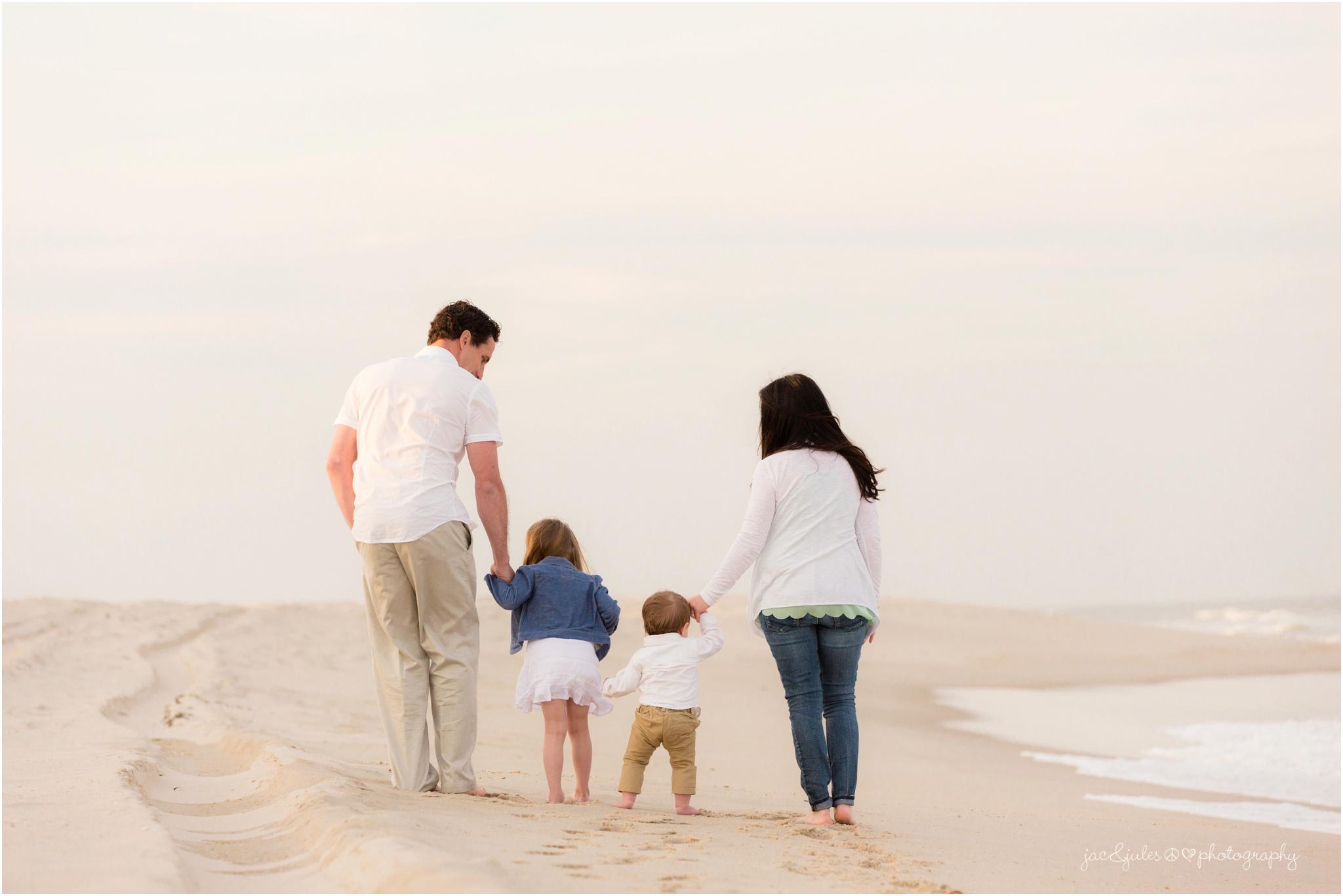 family walking on the beach in seaside park