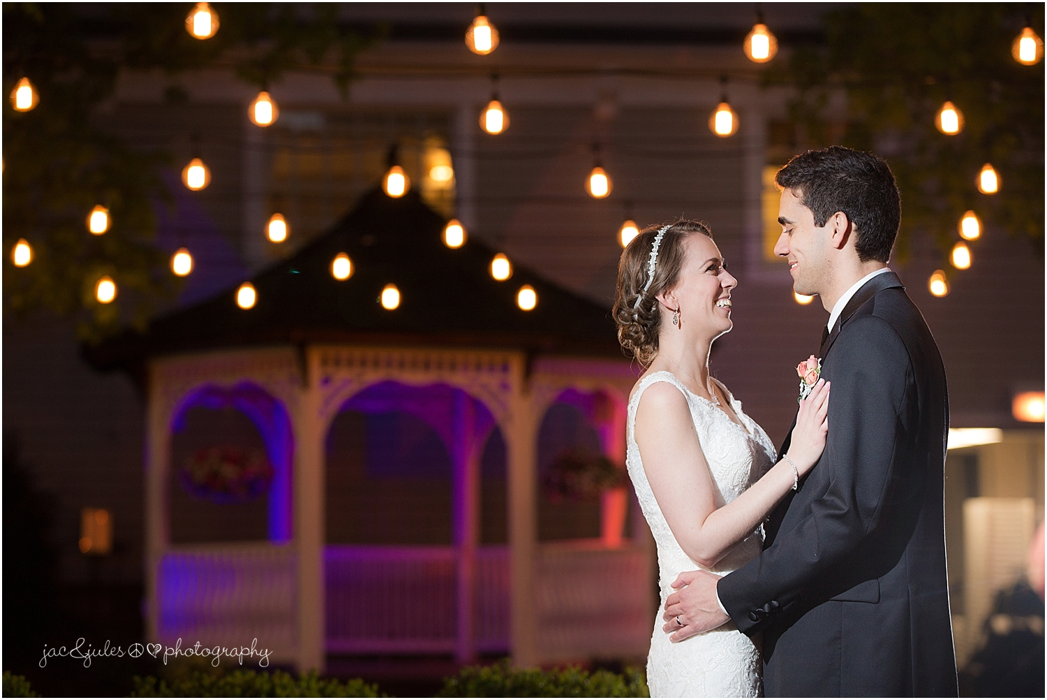 jacnjules takes a nighttime photo of the bride and groom at their wedding at olde mill inn in basking ridge nj