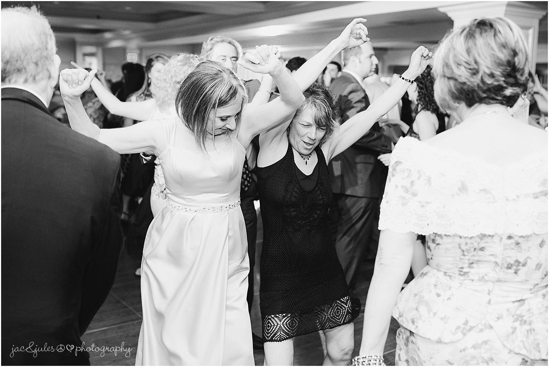 jacnjules photographs fun wedding reception at olde mill inn in basking ridge nj
