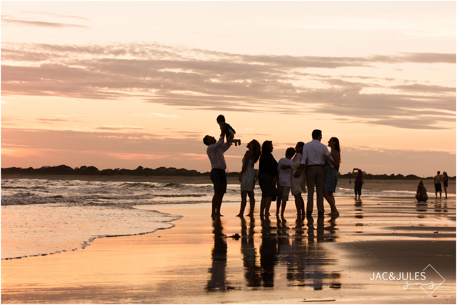 silhouette photo of extended family on the beach in cape may, nj