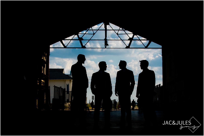 jacnjules photographs groomsmen in gray suits in Asbury Park, NJ