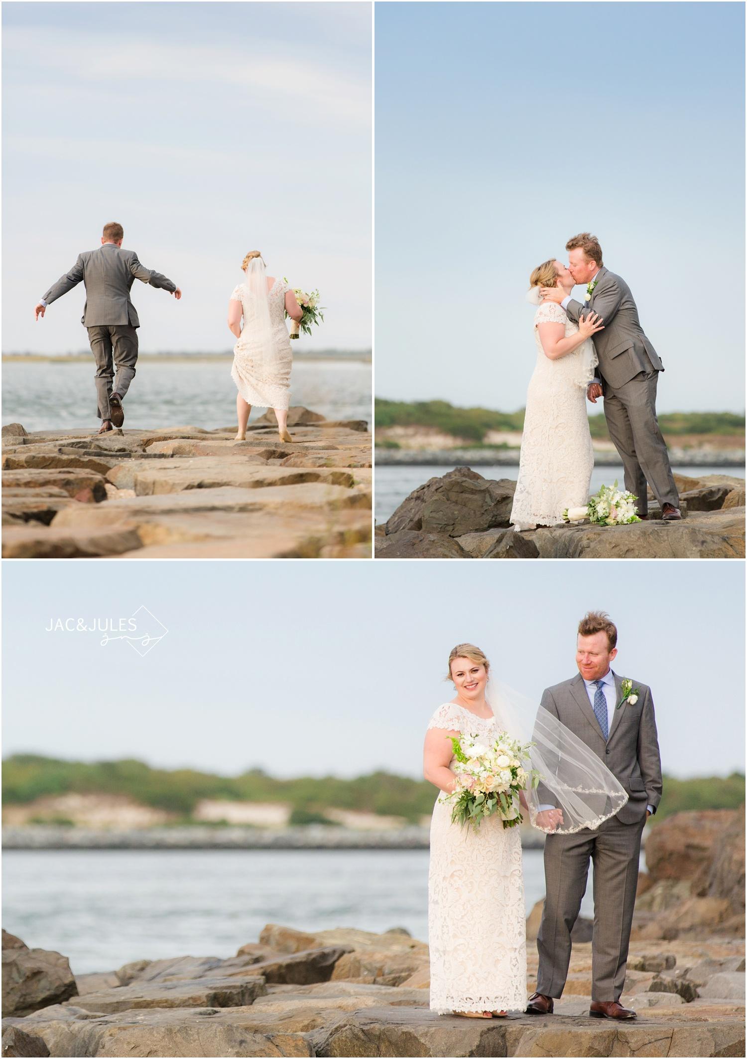 bride and groom photos on rocks at barnegat lighthouse in Long Beach Island, NJ