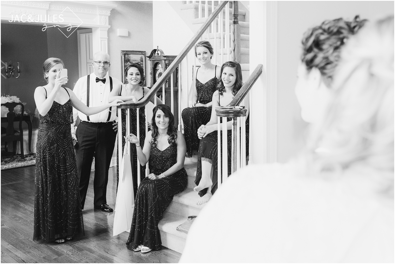 putting on bridal gown during bride prep in Manasquan NJ.