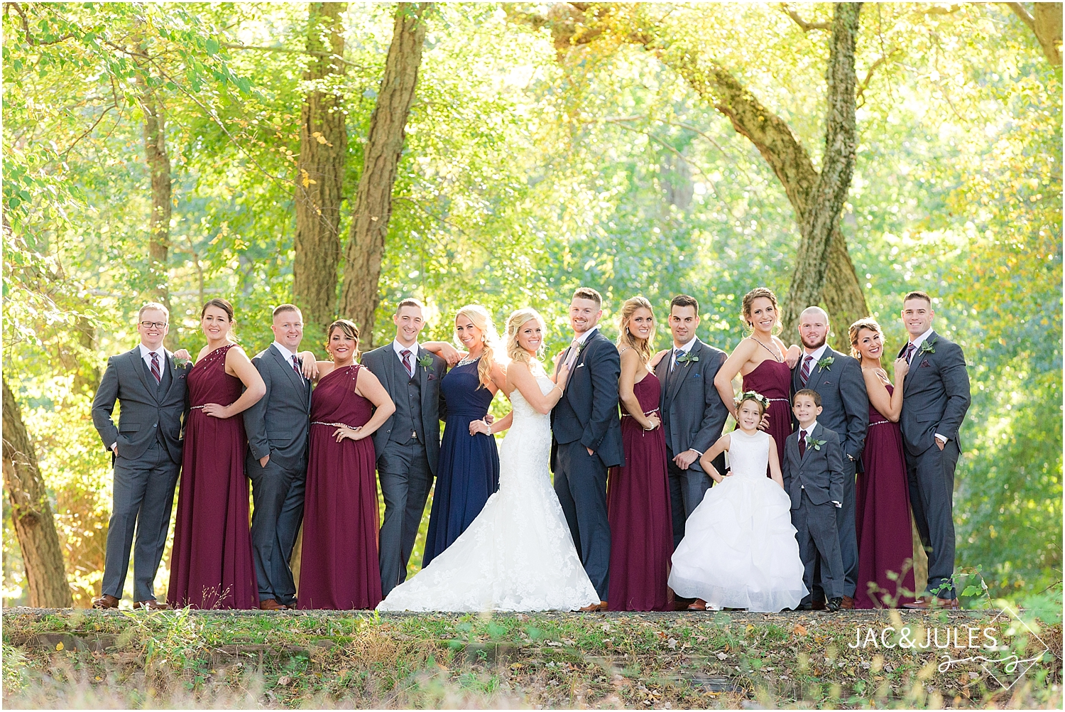 jacnjules photographs bridal party wearing navy and maroon at Allaire State Park, NJ