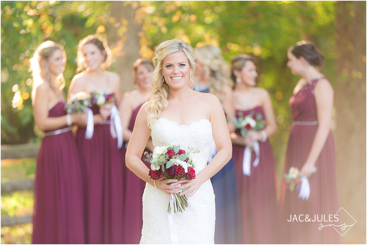 jacnjules photographs bride and bridesmaids wearing navy and maroon at Allaire State Park