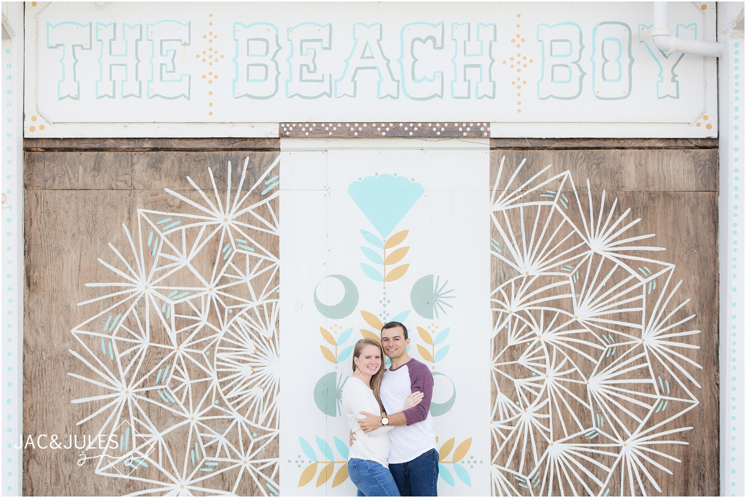 engagement photos by beach boy mural at the Asbury Park Boardwalk