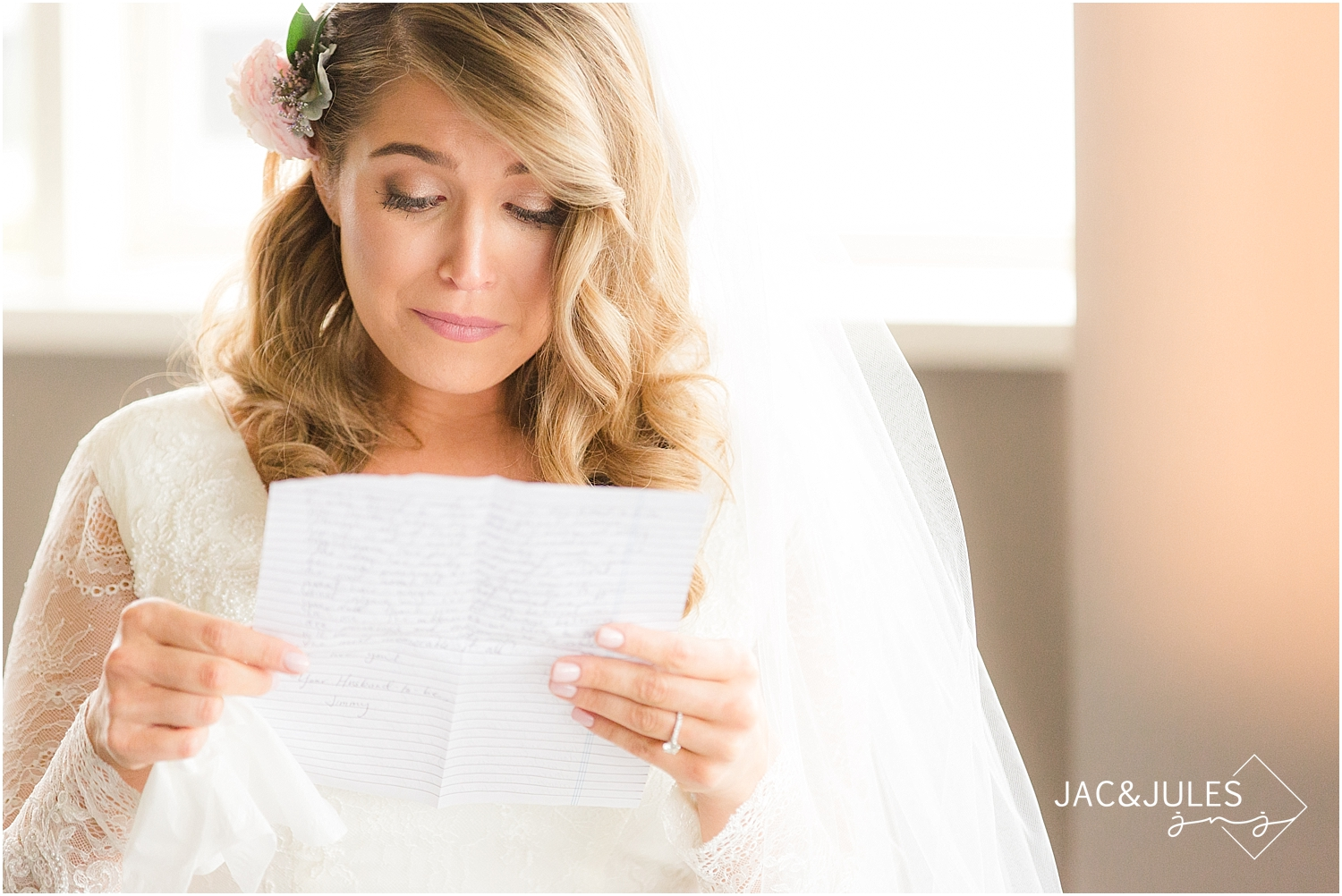 jacnjules photographs bride reading letter from groom at Oyster Point