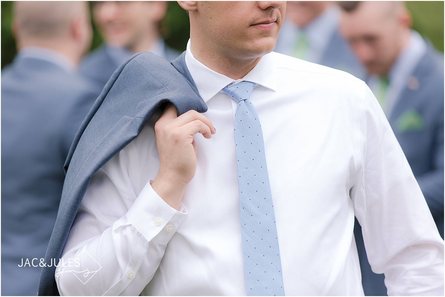 jacnjules photographs groom in his blue suit from The Tie Bar