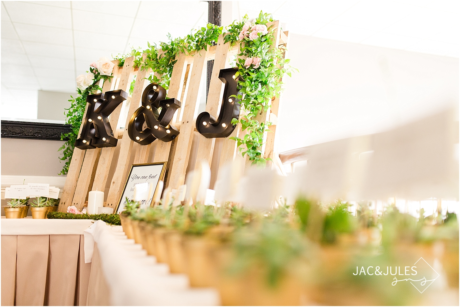jacnjules photographs rustic wedding details using succulents, palettes and greenery at Oyster Point