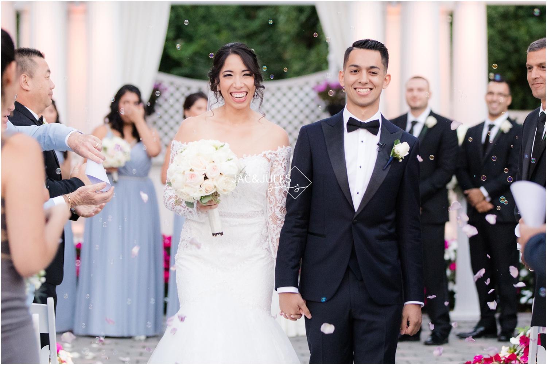 Bride and groom exit wedding ceremony at The Shadowbrook in Shrewsbury, NJ.
