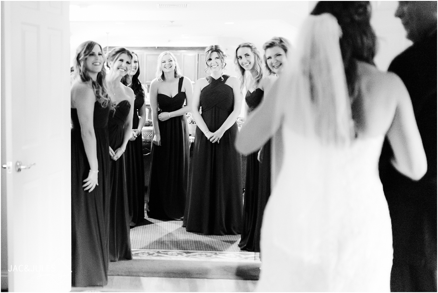 First look with bridesmaids at The Olde Mill Inn in Basking Ridge, NJ.