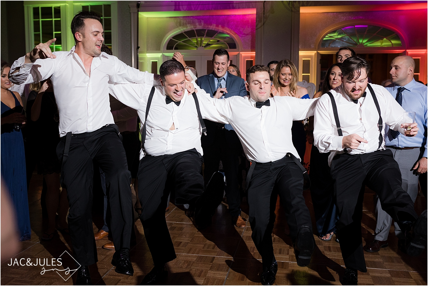 groom with his groomsmen dancing at wedding reception