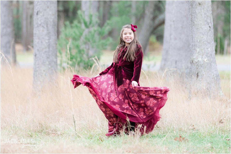 girl twirling her dress at ocean county park