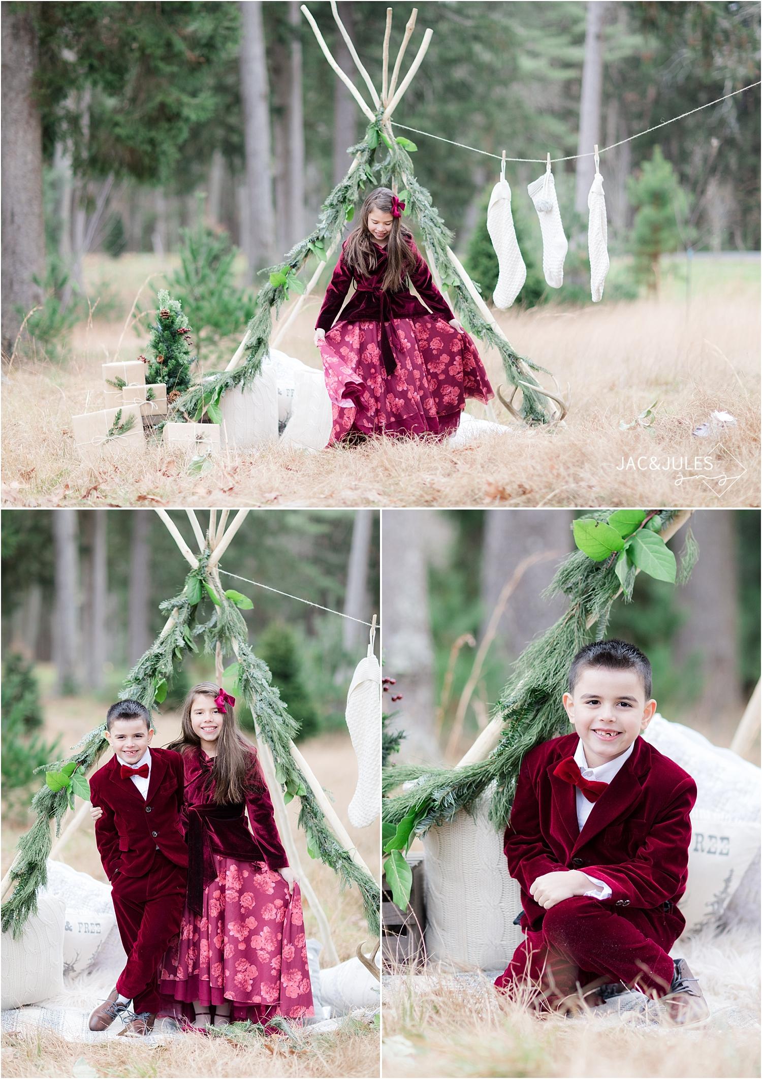 teepee christmas photo with little girl walking