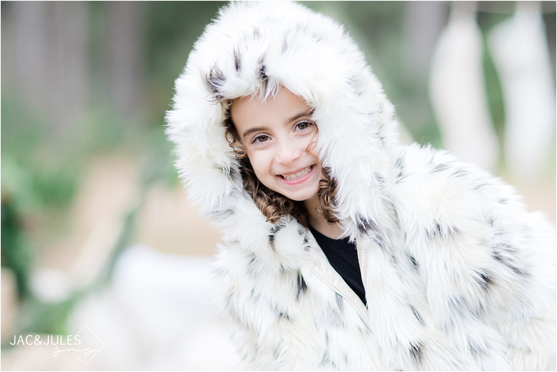 close up of little girl in winter coat in nj