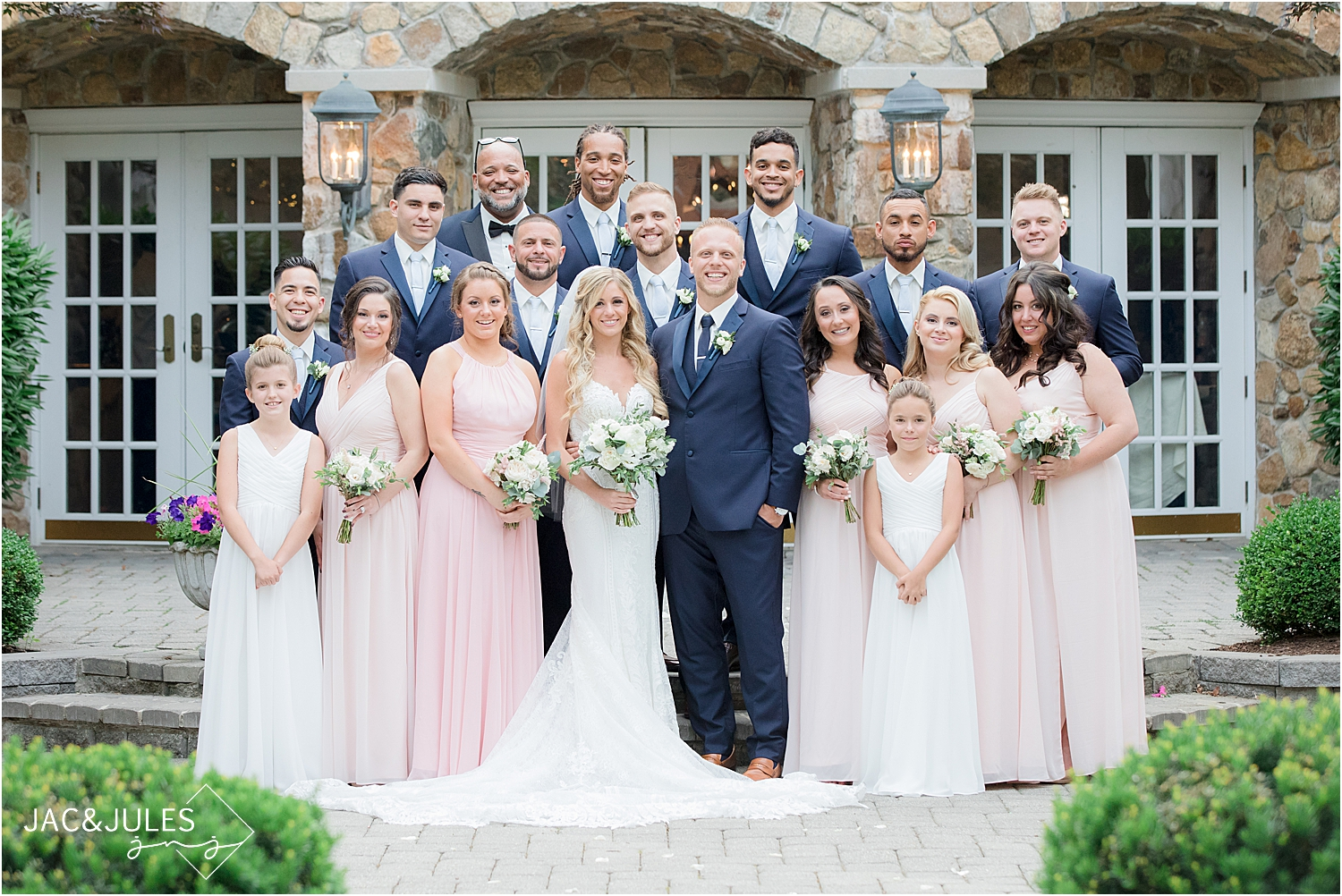 bridal party photo in the Olde Mill Inn courtyard