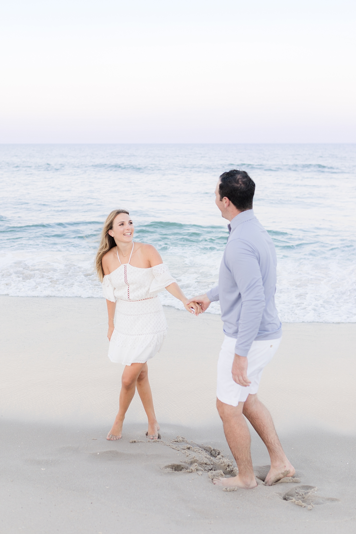 playful engagement photo on the beach in seaside park nj