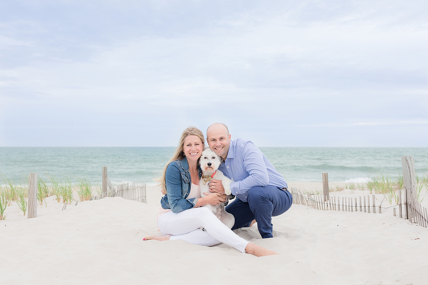 engagement photo with their dog on the beach in seaside park NJ