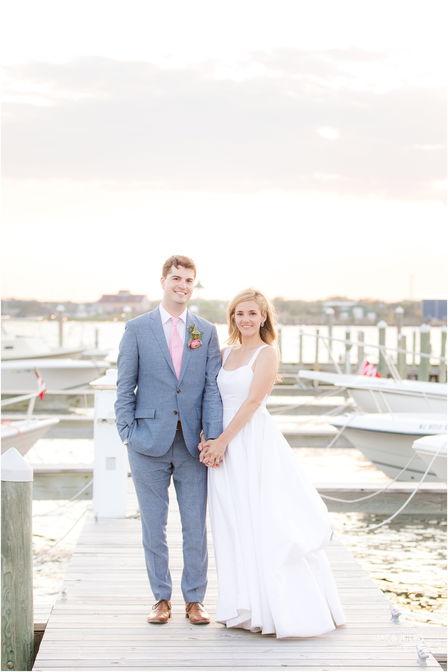 Romantic Just married photo at sunset on the dock at Mantoloking Yacht Club