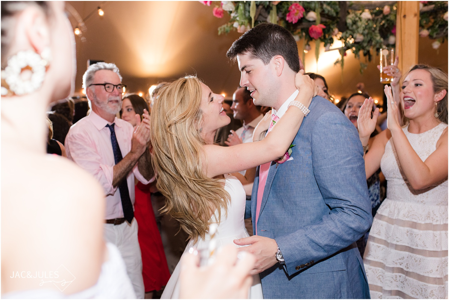 Bride and groom dancing to final song of the night during their tented wedding reception at Mantoloking Yacht Club.