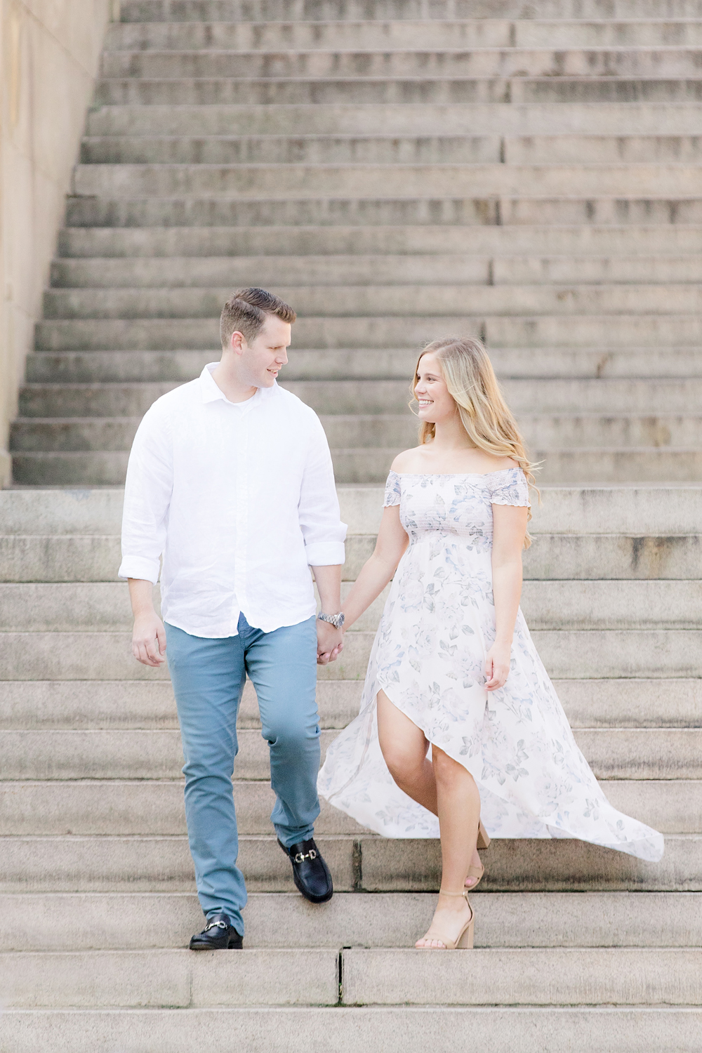 central park NY engagement photo of couple walking down steps