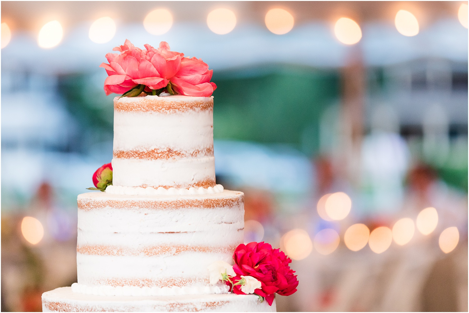 Naked wedding cake with pink florals by Faye and Renee.