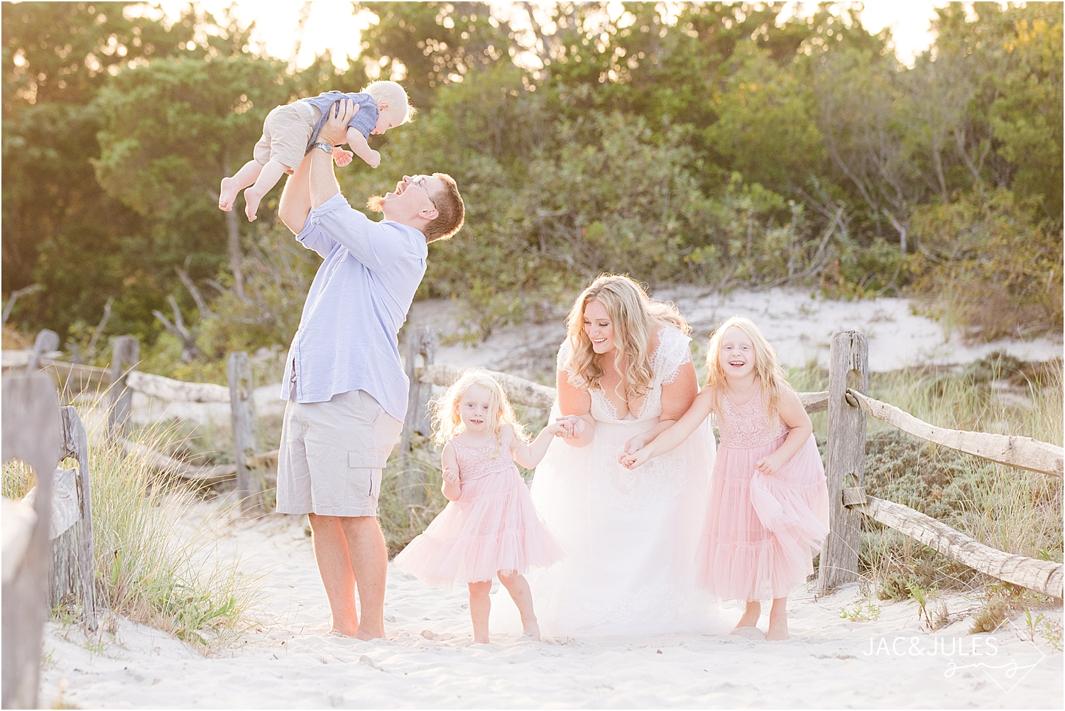 family photo at island beach state park with girls in flowing dresses in natural light at sunset by jacnjules