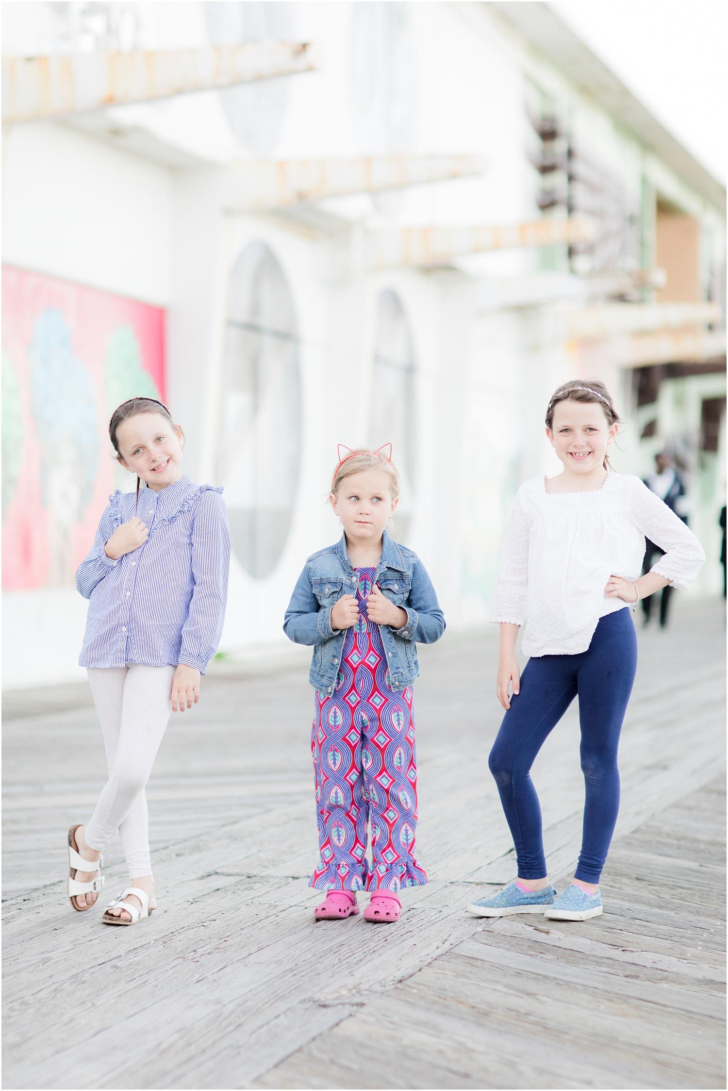 3 girls posing in front of Asbury Park boardwalk murals