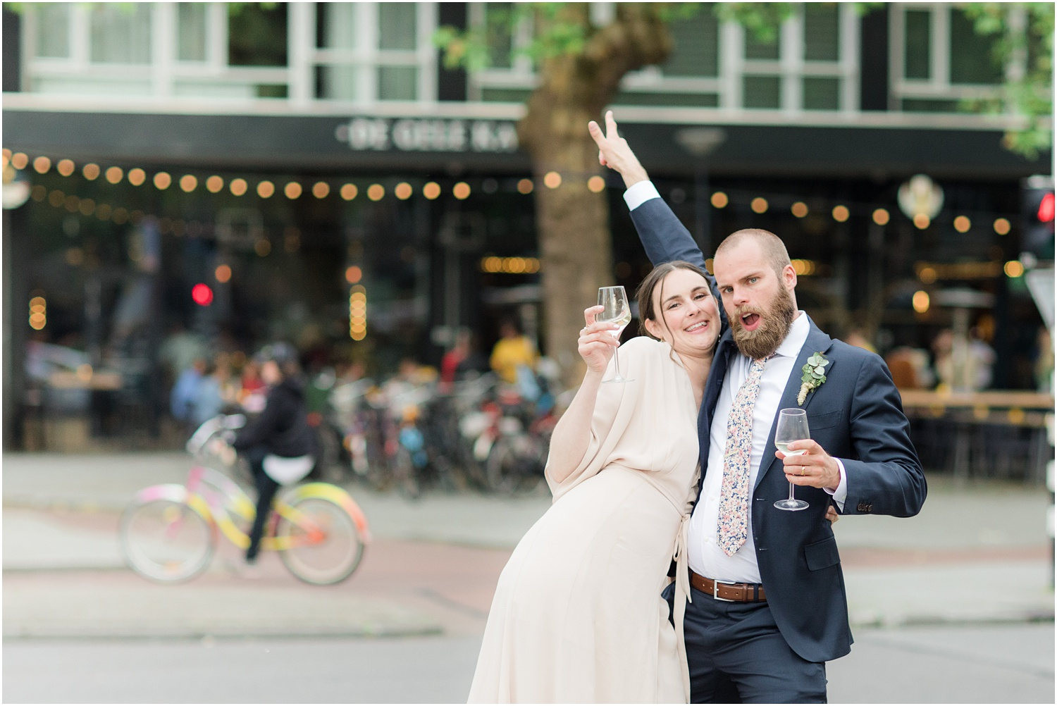 fun bride and groom photos on the streets of Rotterdam