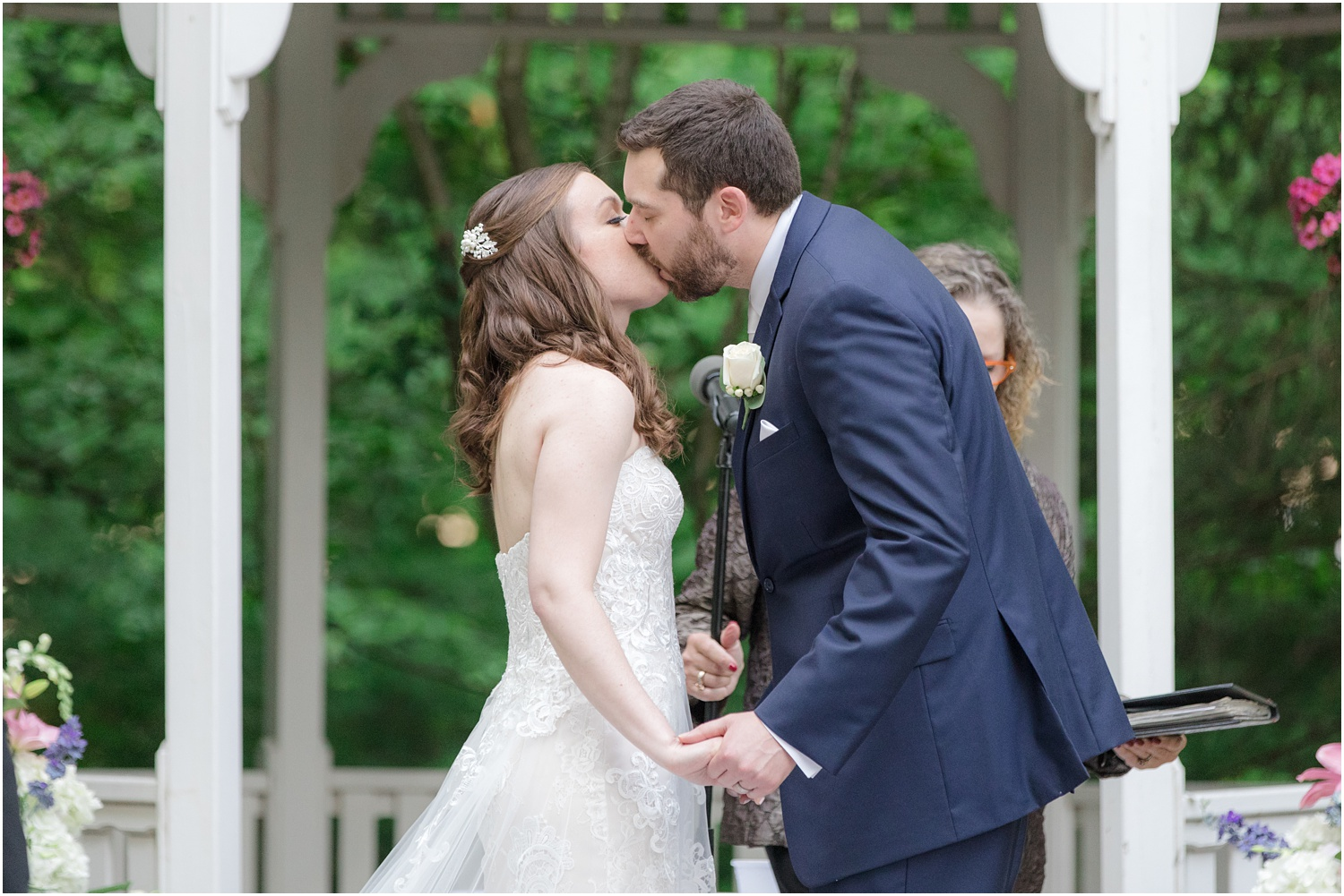 First kiss during Ceremony at The Grain House at Olde Mill Inn