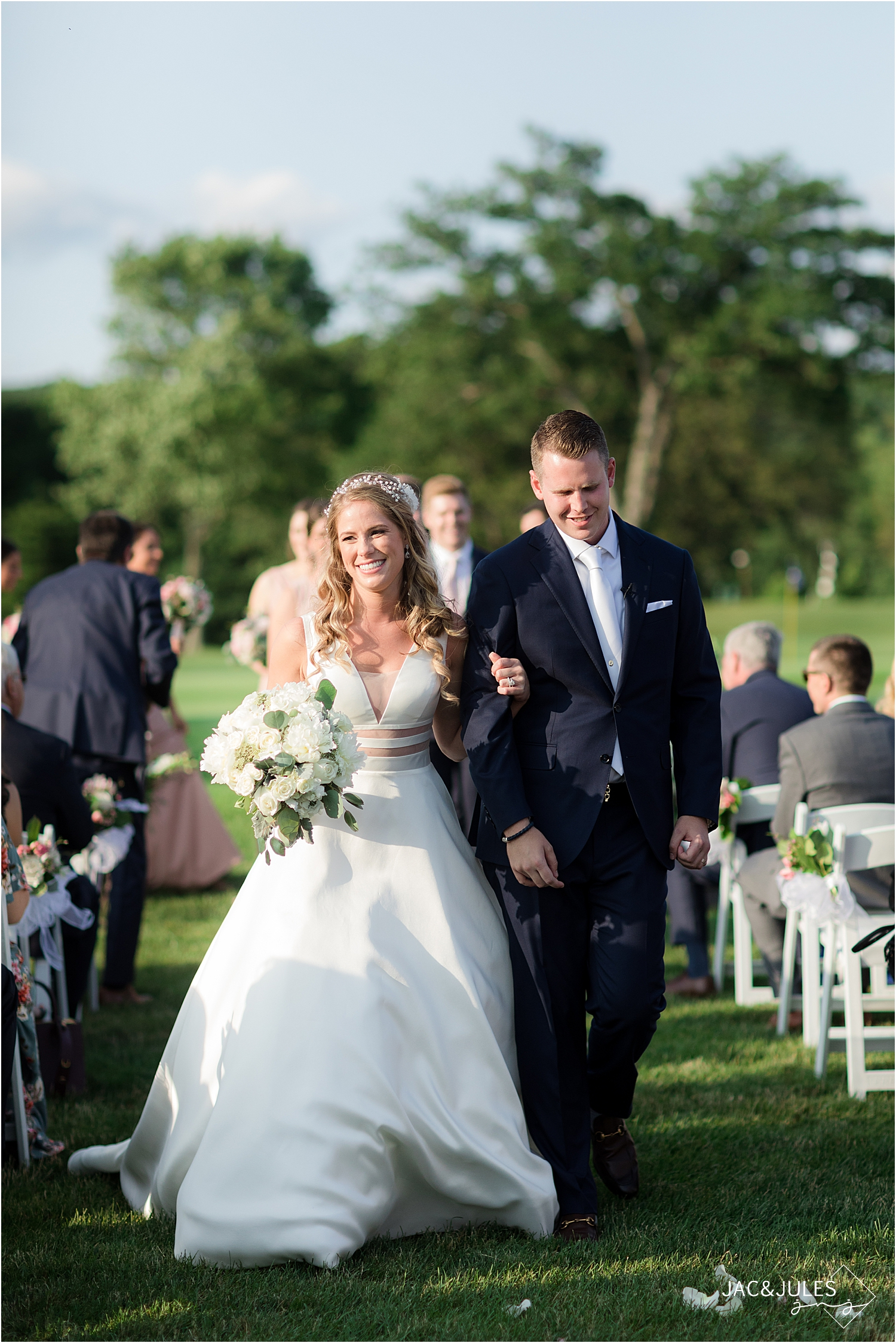 bride and groom walk down the aisle at north jersey country club wedding