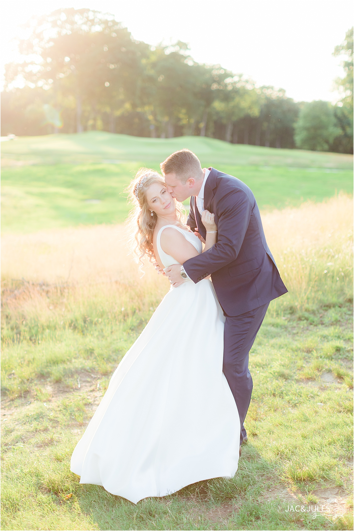 groom kisses brides cheer at country club wedding in north jersey