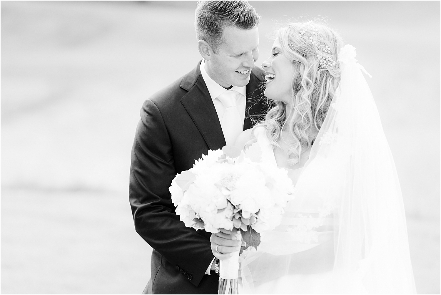 bride and groom laughing at north jersey country club wedding
