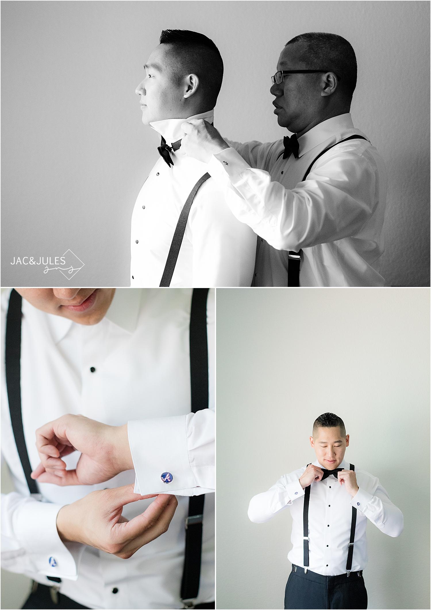 dad helping groom get ready for wedding