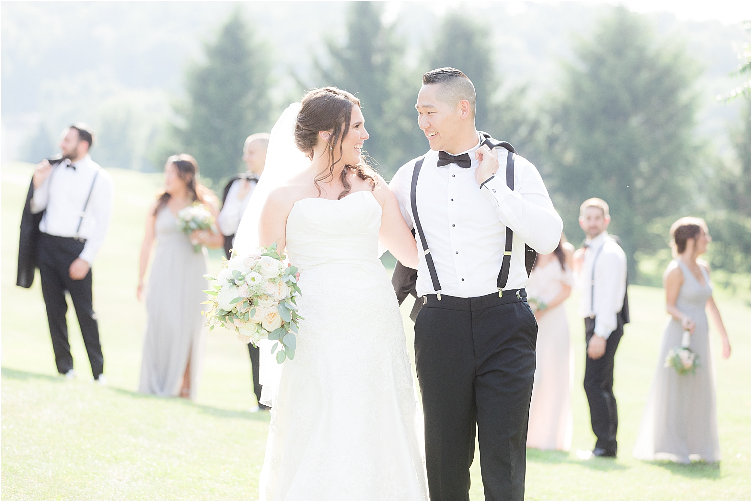 bride and groom walk in front of the bridal party at SKyview Golf Club wedding