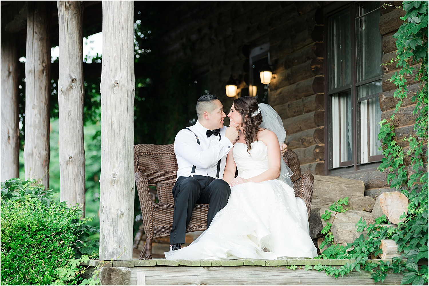 bride and groom kiss on the porch at Skyview Golf Club wedding