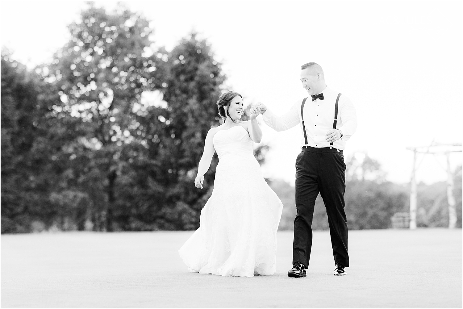 fun photo of bride and groom at sunset at sky view golf club wedding