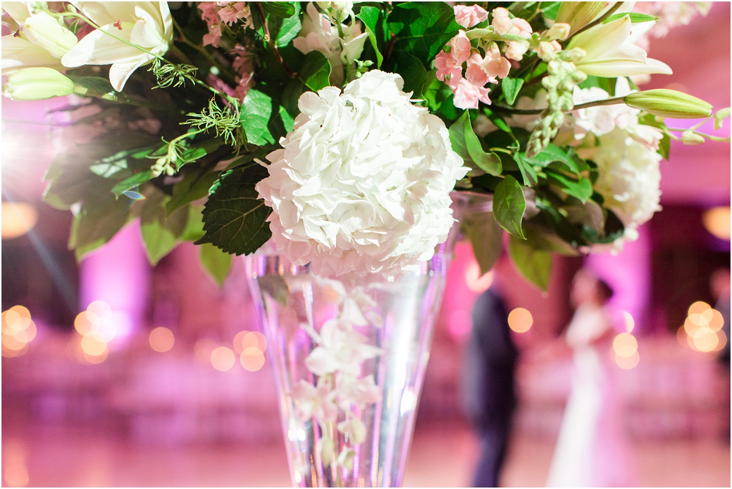 Wedding reception decor with pink uplighting at South Gate Manor in Freehold.