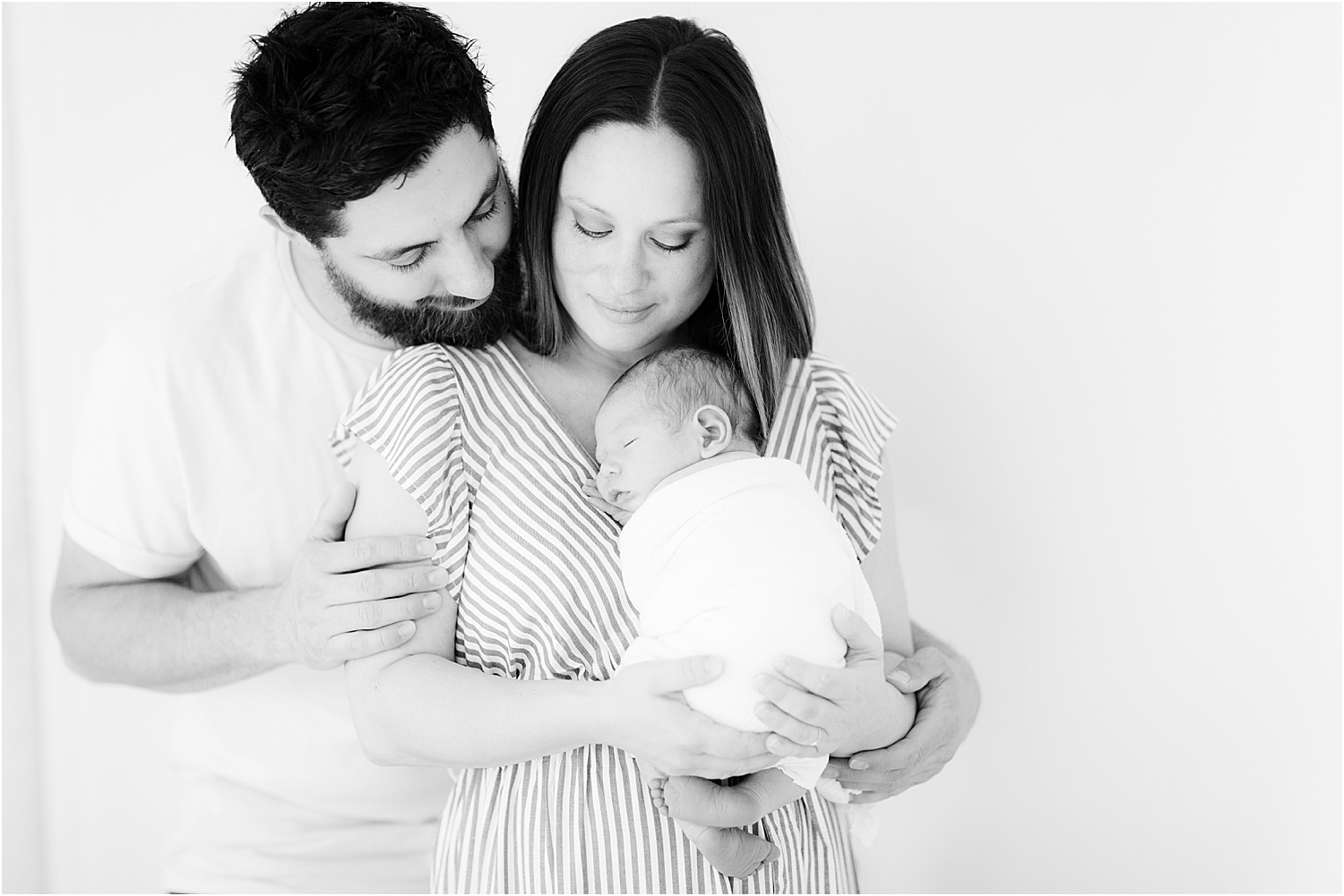 in home photo of newborn with parents