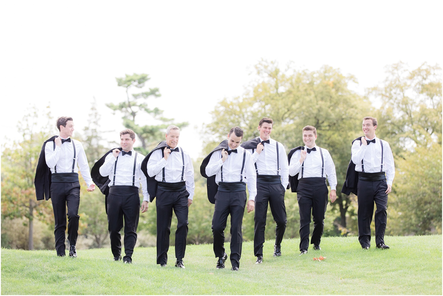 Groomsmen walking on the golf course at Canoe Brook Country Club