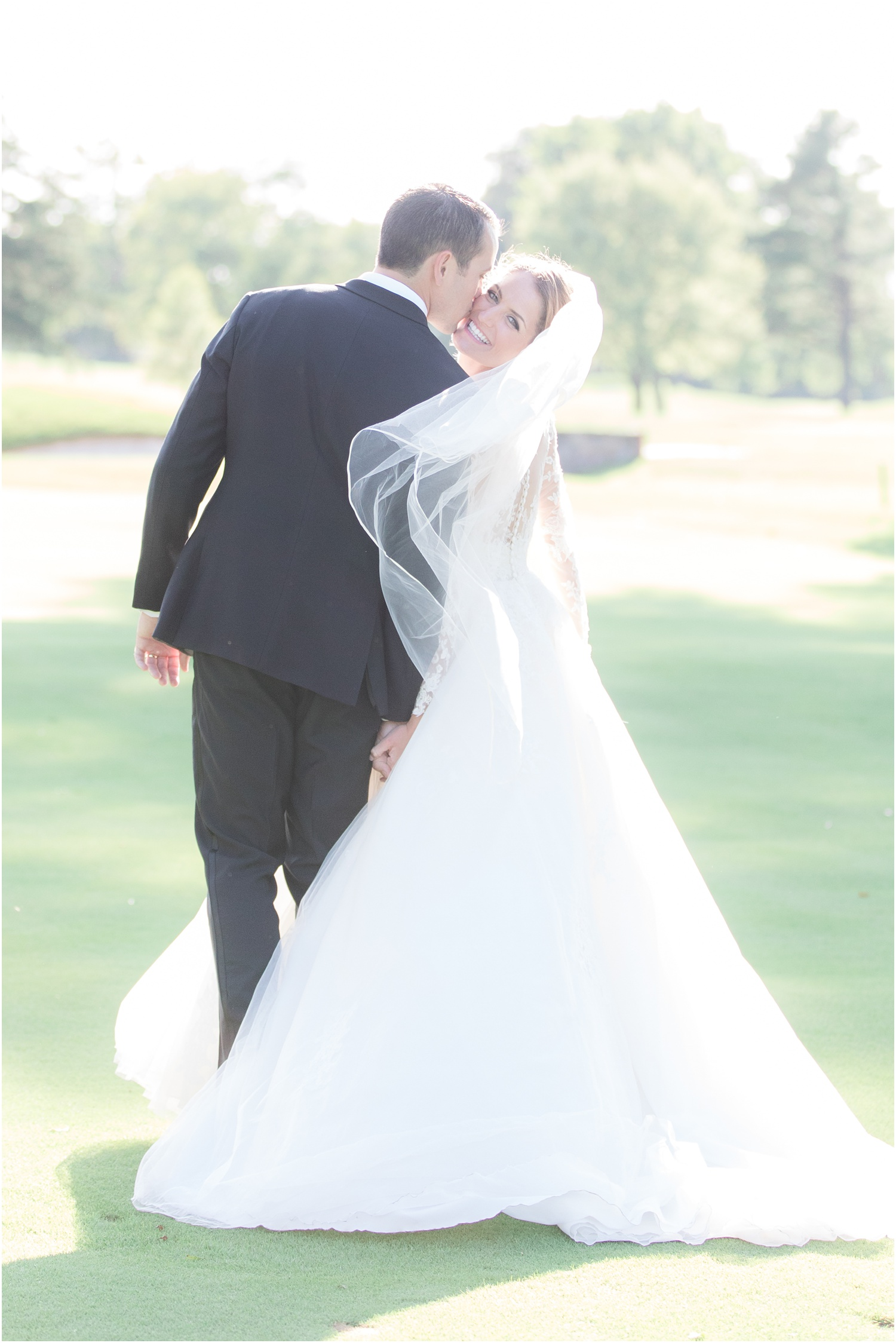 groom kissing bride on the cheek at Canoe Brook Country Club