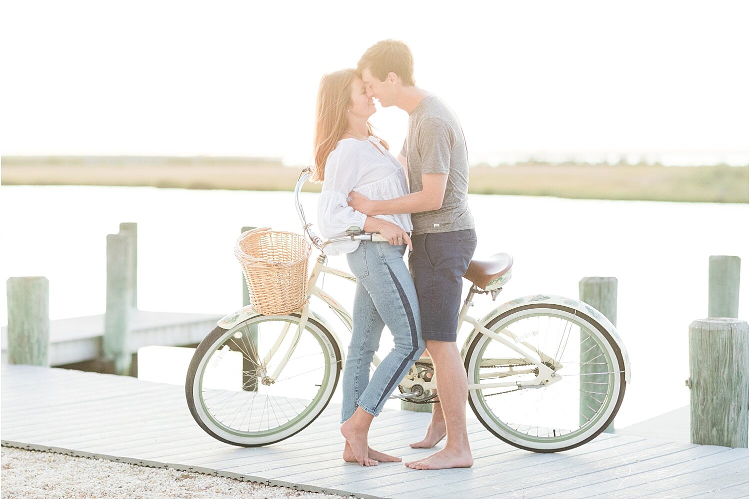 romantic beach engagement photo in LBI with a bike